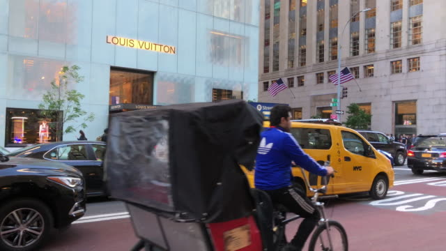 louis vuitton is a french fashion house and luxury retail company. - yellow taxi stock-videos und b-roll-filmmaterial