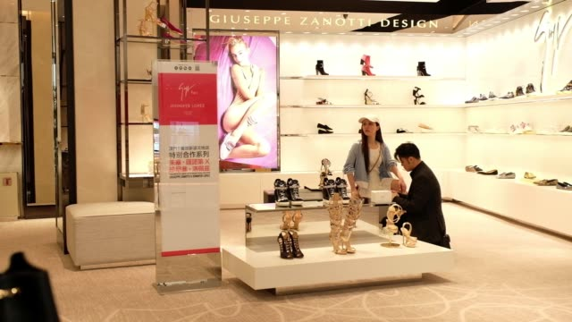 louis vuitton retail store stands on the boulevard at studio city casino resort, developed by melco crown entertainment ltd., in macau, china on... - louis vuitton designer label stock videos & royalty-free footage