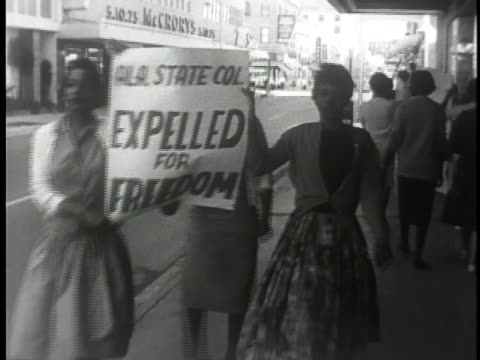 louisiana black women demonstrate for civil rights as they carry signs on a downtown sidewalk. - equality stock videos & royalty-free footage