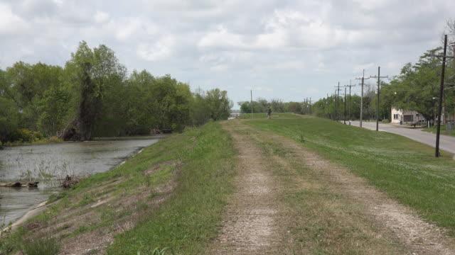 louisiana view down a levee by a road - louisiana video stock e b–roll