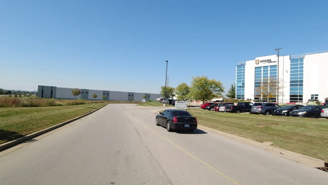 louisville, kentucky, usa - october 7th, 2020: dolly shot of amazon fulfillment center sign in america in a sunny day amid the 2020 global... - dolly shot stock videos & royalty-free footage