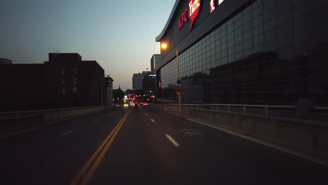 louisville, kentucky, usa - october 7th, 2020: driving through the george rogers clark memorial bridge at twilight past kfc yum center amid the 2020... - vanishing point stock videos & royalty-free footage