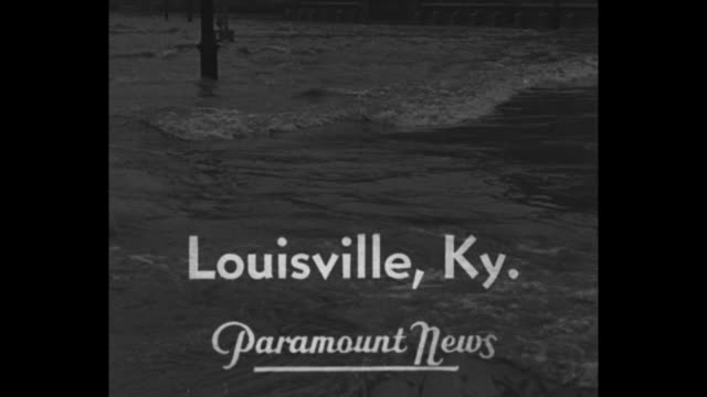 vidéos et rushes de louisville ky superimposed on floodwaters / vs men in boat quickly floating down flooded business district / vs men moving pontoon walkway structure... - film documentaire image animée