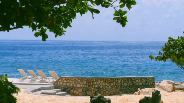 lounge chairs in tropical paradise - jamaica stock videos & royalty-free footage