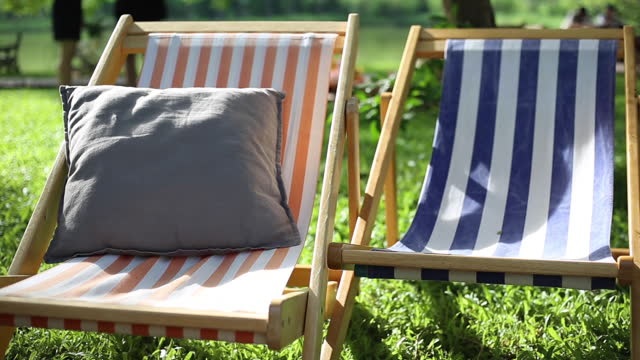 lounger for relaxation in the garden - deckchair stock videos & royalty-free footage