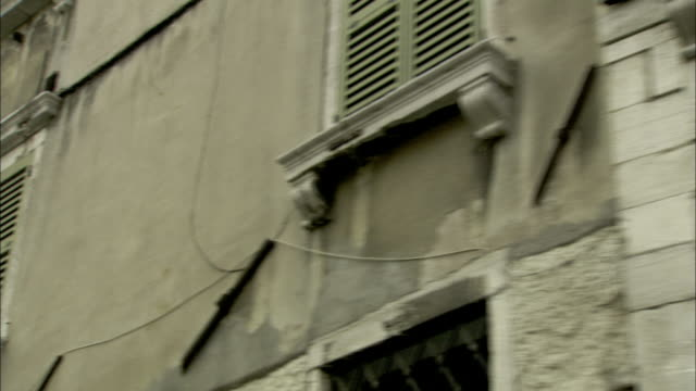 louvered shutters characterize ghetto apartments in venice. available in hd. - facade stock videos & royalty-free footage