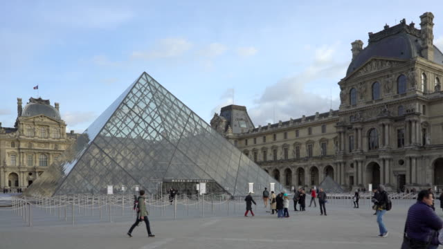 louvre pyramid, pyramide du louvre paris in winter. - louvre stock videos and b-roll footage