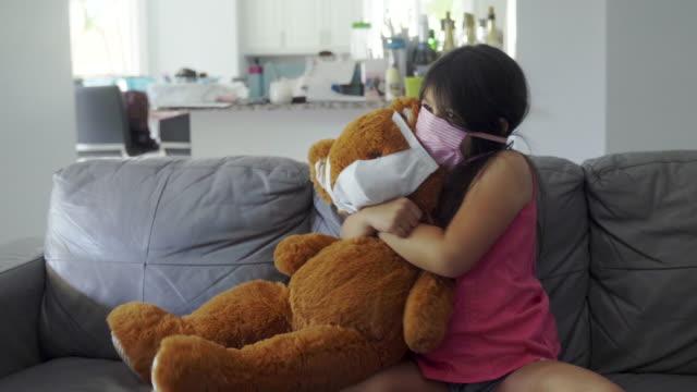 i love and protect my teddy bear against the virus - teddy bear stock videos & royalty-free footage