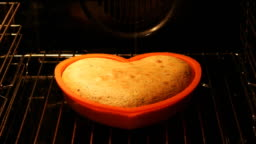 Love cake rising in the oven