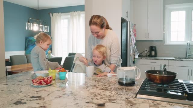 i love chocolate milk - mother with her children preparing breakfast - chocolate milk stock videos & royalty-free footage