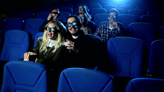 Love couple kissing in the cinema