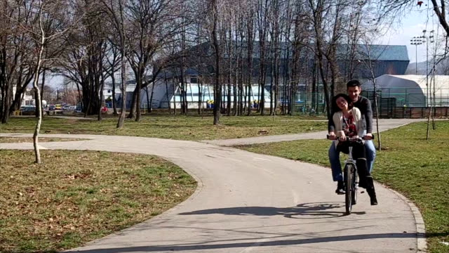 love couple on bicycle
