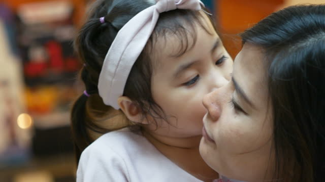 love eternity concept , mother and daughter kissing together