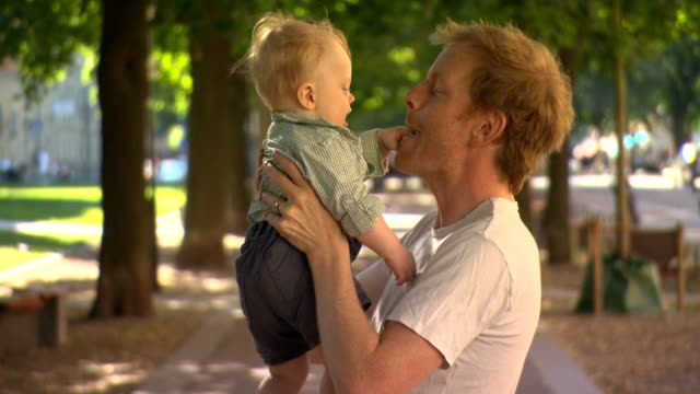 stockvideo's en b-roll-footage met love, father with happy baby son. - genderblend