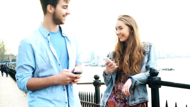 love is in the air. young couple attraction. - teenage couple stock videos & royalty-free footage