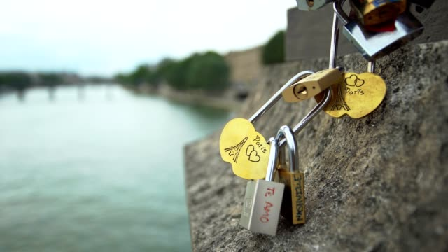 love lock bridge, paris - france - romantic activity stock videos & royalty-free footage