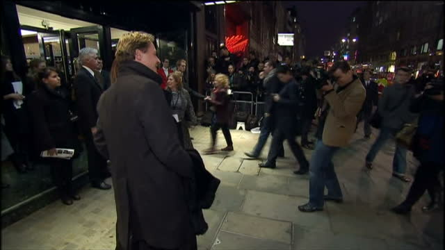 'love never dies' premiere at the adelphi theatre in london shows exterior night shots of geoffroy medinger and sumi jo posing for photographers - adelphi theatre stock videos & royalty-free footage