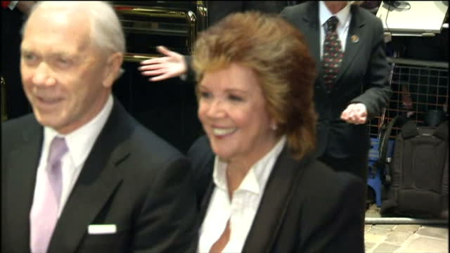 'love never dies' premiere at the adelphi theatre in london shows exterior night shots of cilla black and guest arriving at the premiere and posing... - adelphi theatre stock videos & royalty-free footage