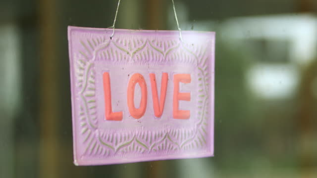 love sign on retail store during covid-19 - store sign stock videos & royalty-free footage