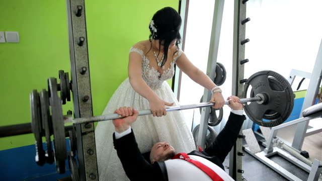 love story. gym love turns to marriage - muscular build stock videos & royalty-free footage