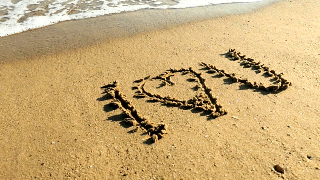 i love you message in sand - romantic activity stock videos & royalty-free footage