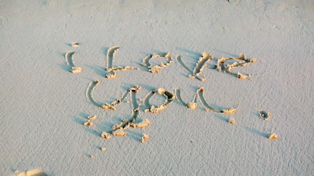 ms ha i love you written in sand and washed away by ocean, isla mujeres, quintana roo, mexico - i love you stock videos & royalty-free footage