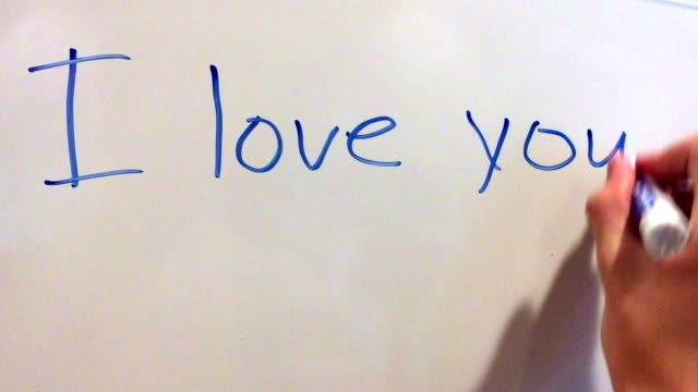 """i love you"" written out on whiteboard - i love you stock videos and b-roll footage"