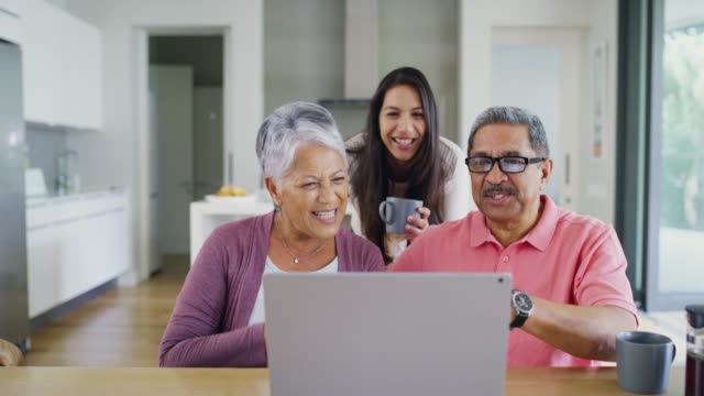 loved ones are closer than ever before thanks to technology - adult offspring stock videos & royalty-free footage