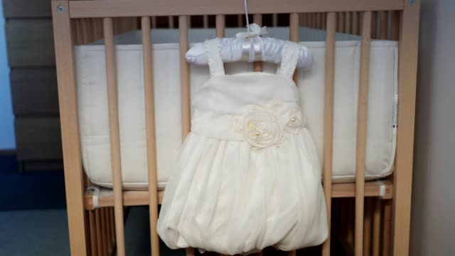lovely baby dress on a baby crib - cot stock videos & royalty-free footage