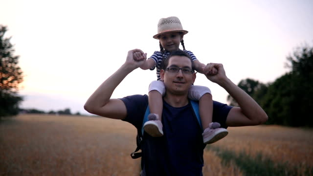 lovely child and her father in nature - rural scene stock videos & royalty-free footage