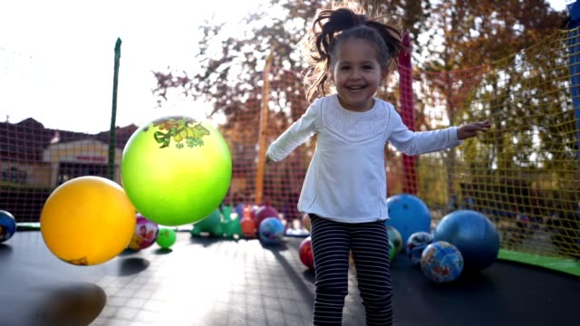 lovely child having fun on a trampoline - toddler stock videos & royalty-free footage