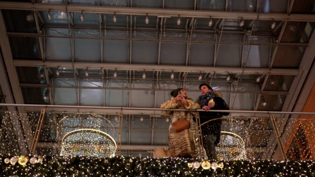 lovely couple in a christmas decorated shopping mall - romance stock videos & royalty-free footage