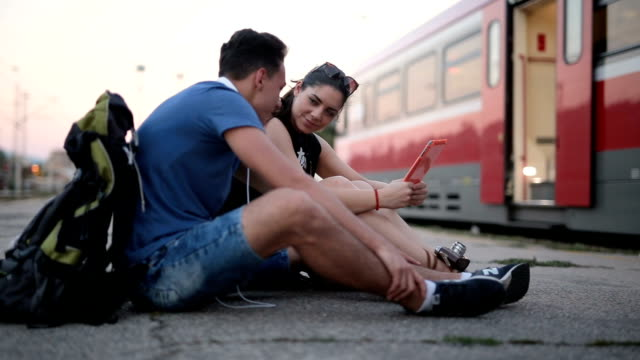 Lovely couple on a train station