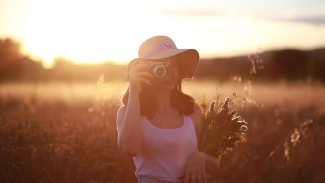 lovely hipster girl photographing nature in late summer - analog stock videos and b-roll footage