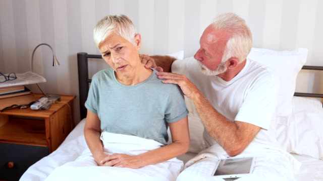 lovely husband massaging his wife in a morning - massage room stock videos & royalty-free footage
