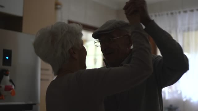 lovely senior couple dancing at home - face to face stock videos & royalty-free footage