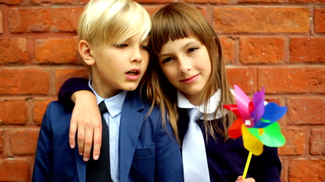 Lovely siblings plays with pinwheels
