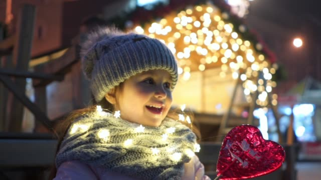 lovely smiling child enjoying christmas in the city - season stock videos & royalty-free footage