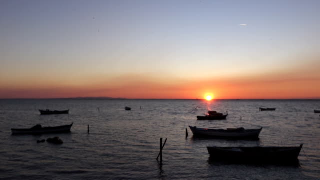 lovely sunset with boats on the sea - aydın province stock videos and b-roll footage