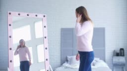 Lovely woman admiring her reflection in mirror
