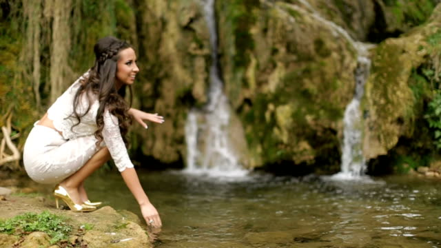 lovely woman by waterfall - falling water stock videos & royalty-free footage