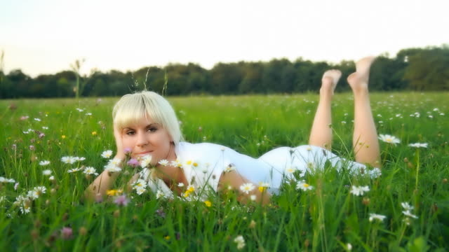 HD DOLLY: Lovely Woman Day Dreaming In Meadow
