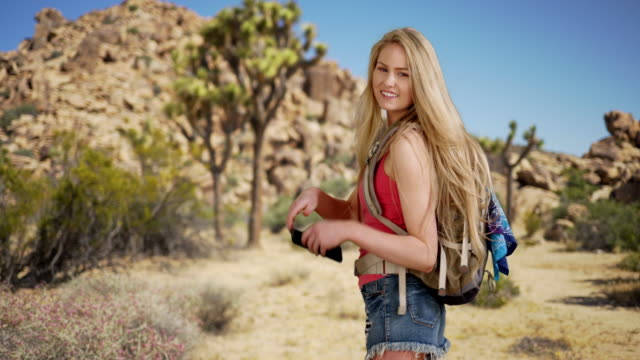 lovely young adult female hiking joshua tree park in spring - joshua tree stock videos and b-roll footage