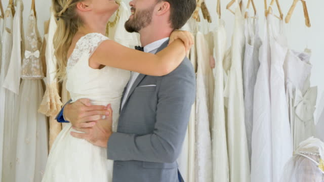 lover couple falling in love and dancing together - abito da sposa video stock e b–roll
