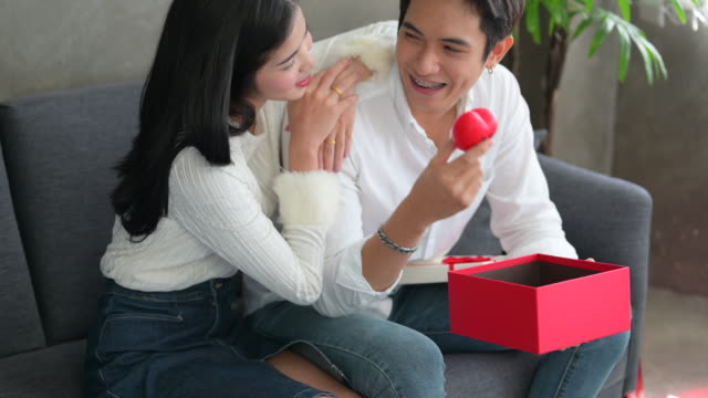 lover in valentine's day, give present box, rose and hug kiss together - husband stock videos & royalty-free footage