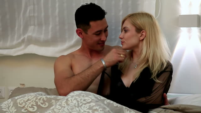 lovers in bed - hd format stock videos & royalty-free footage