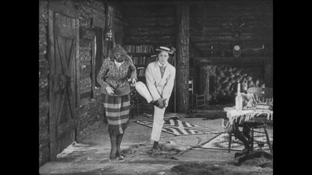 1922 Lovesick man (Buster Keaton) unnerves woman before handing her a flaming rose