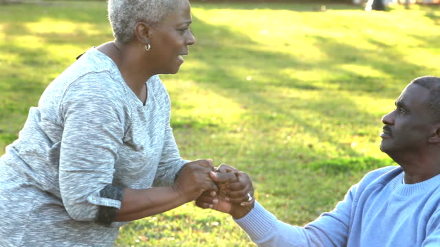 loving african american senior couple, man in wheelchair - healthcare worker stock videos & royalty-free footage