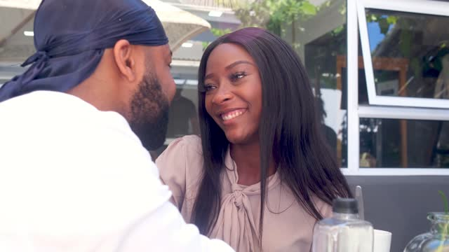 loving african couple sit at a coffee shop on a coffee date - chemistry stock videos & royalty-free footage