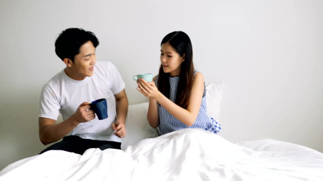 loving boyfriend coming to wake up his girlfriend with cup of coffee. - loving cup stock videos & royalty-free footage